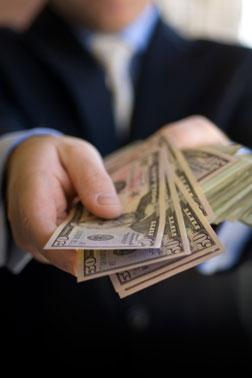 handing-over-cash_100177776_s1